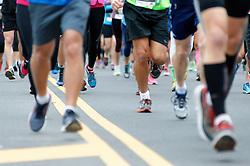 Teklu Deneke, of USA, and Gisele Olalde Granados, of MEX, win the November 22, 2015 Philadelphia Marathon on the Ben Franklin parkway in Center City Philadelphia, PA. A total of 25.000 runners compete in the half and full marathon. (Photo by Bastiaan Slabbers)<br /> <br /> License similar file: http://www.istockphoto.com/photo/philadelphia-marathon-79498095