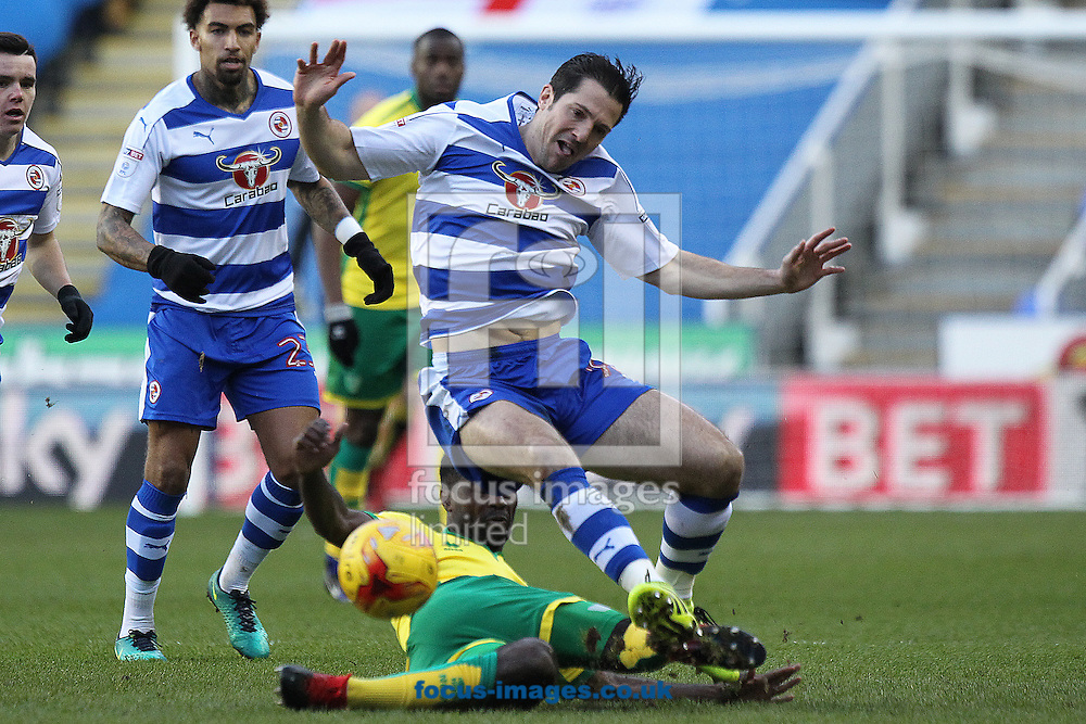 Yann Kermorgant of Reading is fouled by Alexander Tettey of Norwich during the Sky Bet Championship match at the Madejski Stadium, Reading<br /> Picture by Paul Chesterton/Focus Images Ltd +44 7904 640267<br /> 26/12/2016