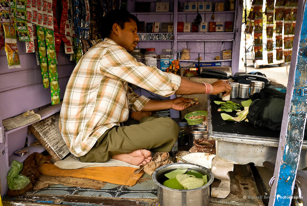 A Paanwala making Paan at a roadside stall in Varanasi, Uttar Pradesh, India