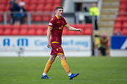 After being jeered by the Motherwell fans when he came on as a substitute, Jake Hastie (#32) of Motherwell FC leaves the field at the final whistle of the Ladbrokes Scottish Premiership match between St Johnstone and Motherwell at McDiarmid Stadium, Perth, Scotland on 11 May 2019.