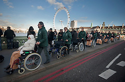 © licensed to London News Pictures. London, UK 30/11/11.A group of medical workers passing the Westminster Bridge to attend the main march in London to demonstrate the pension cuts and tax rises. Photo credit: Tolga Akmen/LNP