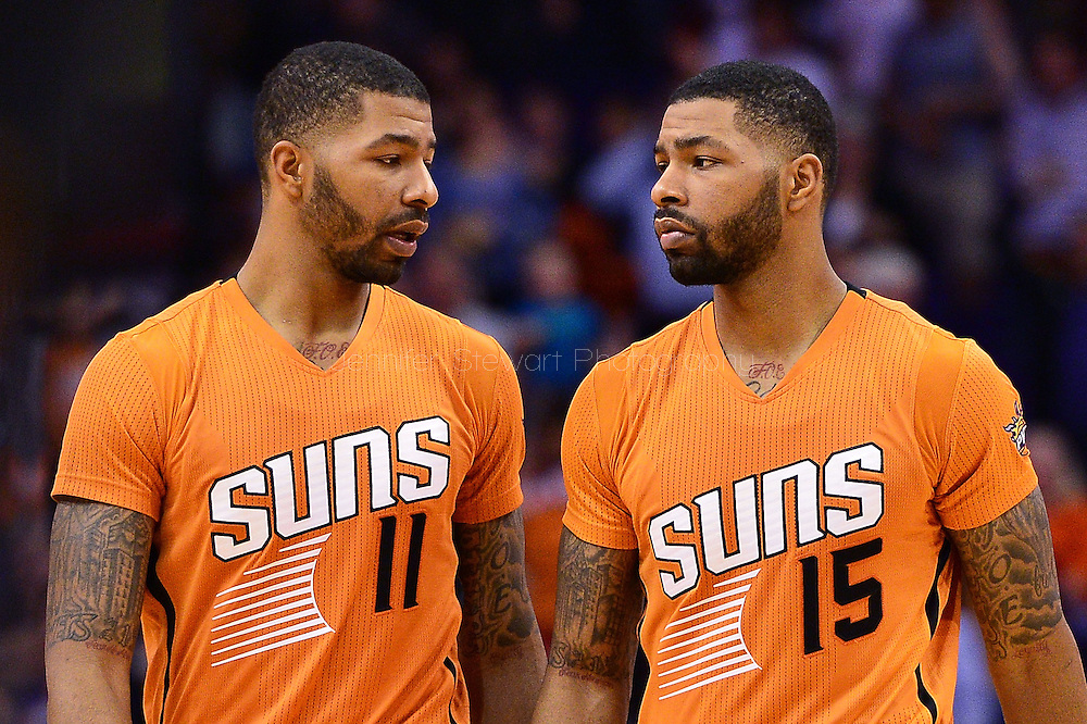 Nov 7, 2014; Phoenix, AZ, USA; Phoenix Suns forward Markieff Morris (11) and forward Marcus Morris (15) talk on the court against the Sacramento Kings at US Airways Center. The Kings won 114-112 in double overtime. Mandatory Credit: Jennifer Stewart-USA TODAY Sports