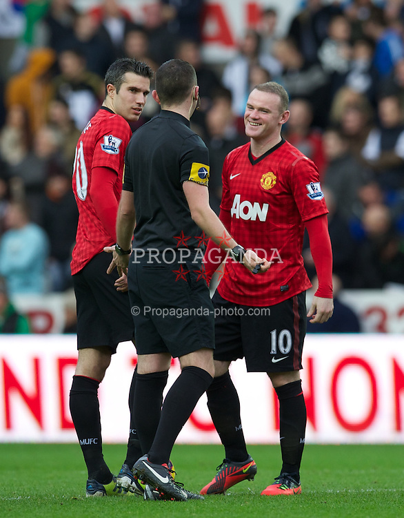 SWANSEA, WALES - Sunday, December 23, 2012: Manchester United's Wayne Rooney shares a joke with referee Michael Oliver during the Premiership match against Swansea City at the Liberty Stadium. (Pic by David Rawcliffe/Propaganda)