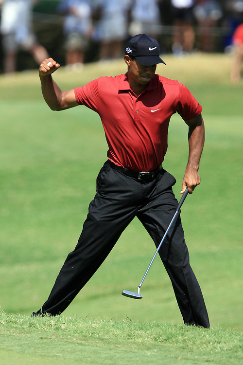 12 August 2007: Tiger Woods pumps his fist after draining a birdie on the 8th green during the final round of the 89th PGA Championship at Southern Hills Country Club in Tulsa, OK.