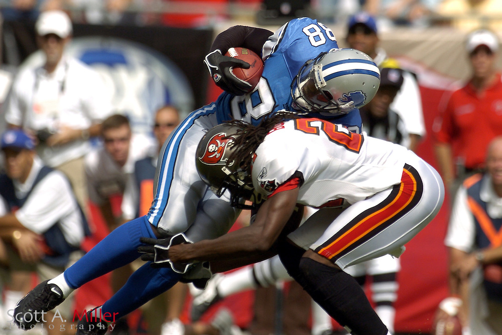 Oct. 5, 2005; Tampa, FL, USA;  Detroit Lions receiver #88 Mike Williams is stopped by Tampa Bay Buccaneers defender Juran Bolden during the fourth quarter of the Bucs 17-13 win at Raymond James Stadium.          ©2005 Scott A. Miller..©2005 Scott A. Miller