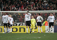 Photo: Lee Earle.<br /> Benfica v Liverpool. UEFA Champions League. 2nd Round, 1st Leg. 21/02/2006. Liverpool's Dietmar Hamann (C) and the players look dejected after Benfica scored.