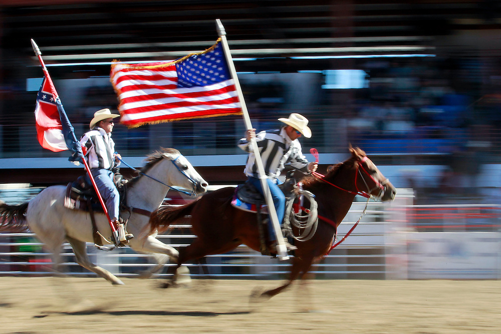 Wildest Show in the South<br /> <br /> Inmates compete in the 48th Annual Angola Prison Rodeo at the Louisiana State Penitentiary Angola in Angola, Louisiana on Sunday, October 28, 2012. With a record breaking attendance of over 16000+ in the inmates competed in a variety of events including bare back horse riding, bull riding, buddy pick up and a crowd favorite convict poker. In the convict poker four convicts are seated at a table in the middle of the arena playing poker when a bull is released, the winner is determined by the last contestant sitting at the table. Providing extra entertainment was a rodeo clown show, John Payne &quot;The One Arm Bandit&quot; a 12 times Professional Rodeo Cowboy Association (PRCA) &quot;Specialty Act of the Year&quot; winner, and Tim Lepard &quot;The Wild Thang&quot; and his goat herding, dog riding monkeys. Even making a Sunday appearance was Warden Burl Cain.