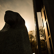 ARLINGTON, VA - A silhouette of one of the two stone sphinxs that stand at the base of the Netherlands Carillon. The Netherlands Carillon, a gift from the Netherlands to the United States in gratitude for assistance during World War II, stands in parkland near the Iwo Jima Memorial and Arlington National Cemetery. With 50 bells, it was installed in its current spot in 1960.