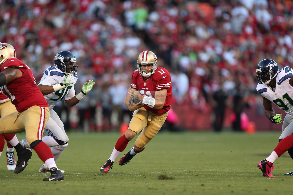 San Francisco 49ers quarterback Alex Smith (11) of the San Francisco 49ers passes against the Seattle Seahawks on Thursday, Oct. 18, 2012 at Candlestick Park in San Francisco. (AP Photo/Jed Jacobsohn)
