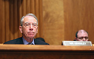 Senator Chuck Grassley (R-IA) looks on during a hearing before the Senate Budget Committee in the Dirksen Senate Office Building in Washington, DC on Wednesday, April 10, 2013.