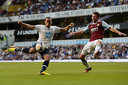 Tottenham Hotspur's Andros Townsend takes a shot at goal as  West Ham United's Razvan Rat defends- Photo mandatory by-line: Mitchell Gunn/JMP - Tel: Mobile: 07966 386802 06/10/2013 - SPORT - FOOTBALL - White Hart Lane - London - Tottenham Hotspur V West Ham United - Barclays Premiership