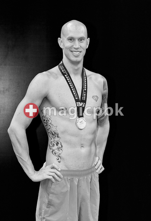 (EDITORS NOTE: Image has been converted to black and white.) Brent HAYDEN of Canada poses with his silver medal won in the men's 100m Freestyle Final at the end of the 14th FINA World Aquatics Championships at the Oriental Sports Center in Shanghai, China, Sunday, July 31, 2011. (Photo by Patrick B. Kraemer / MAGICPBK)
