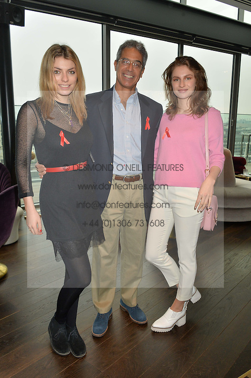 DR MITCH BESSER husband of singer Annie Lennox with his step-daughters (L-R) sisters LOLA LENNOX and TALI LENNOX at the mothers2mothers World AIDS Day VIP Lunch with Next Management & THE OUTNET.COM held at Mondrian London, 19 Upper Ground, London on 1st December 2014.