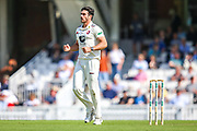 Wicket! Grant Stewart of Kent bowls and celebrates taking the wicket of Dean Elgar of Surrey during the Specsavers County Champ Div 1 match between Surrey County Cricket Club and Kent County Cricket Club at the Kia Oval, Kennington, United Kingdom on 7 July 2019.