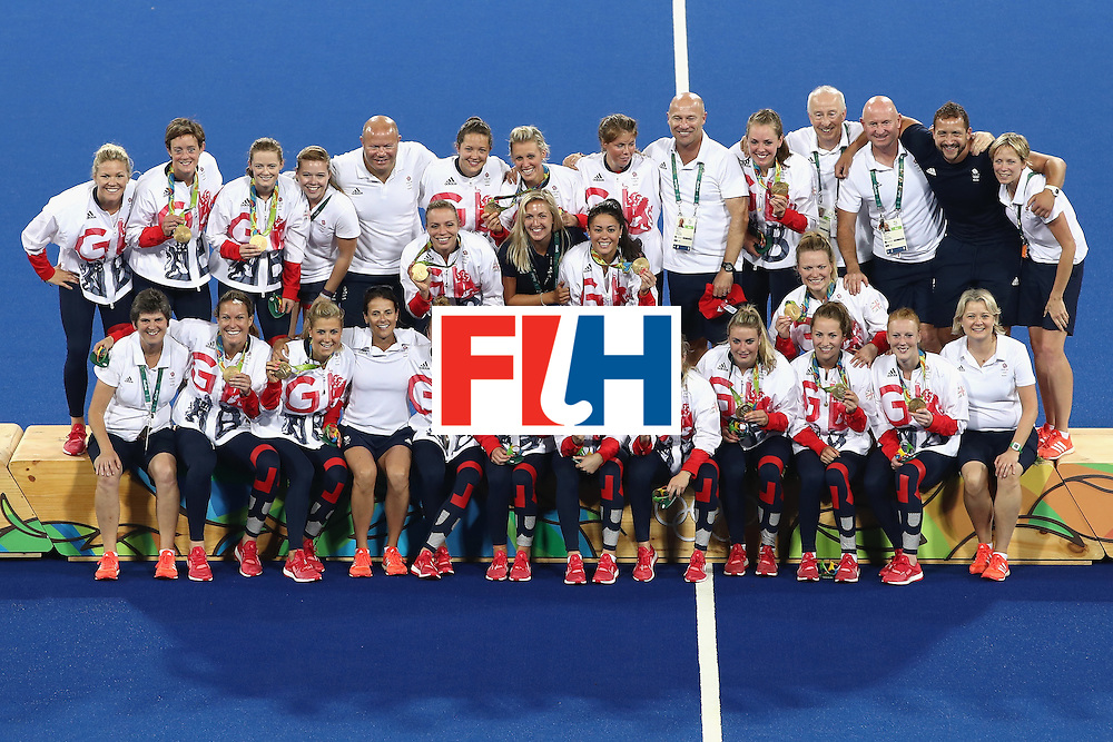 RIO DE JANEIRO, BRAZIL - AUGUST 19:  Team Great Britain pose with their gold medals after defeating Netherlands in the Women's Gold Medal Match on Day 14 of the Rio 2016 Olympic Games at the Olympic Hockey Centre on August 19, 2016 in Rio de Janeiro, Brazil.  (Photo by Mark Kolbe/Getty Images)