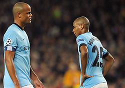 Manchester City's Vincent Kompany and Manchester City's Fernandinho cut dejected figures - Photo mandatory by-line: Dougie Allward/JMP - Mobile: 07966 386802 - 18/03/2015 - SPORT - Football - Barcelona - Nou Camp - Barcelona v Manchester City - UEFA Champions League - Round 16 - Second Leg