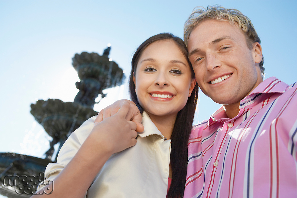 Smiling Couple in Front of Fountain