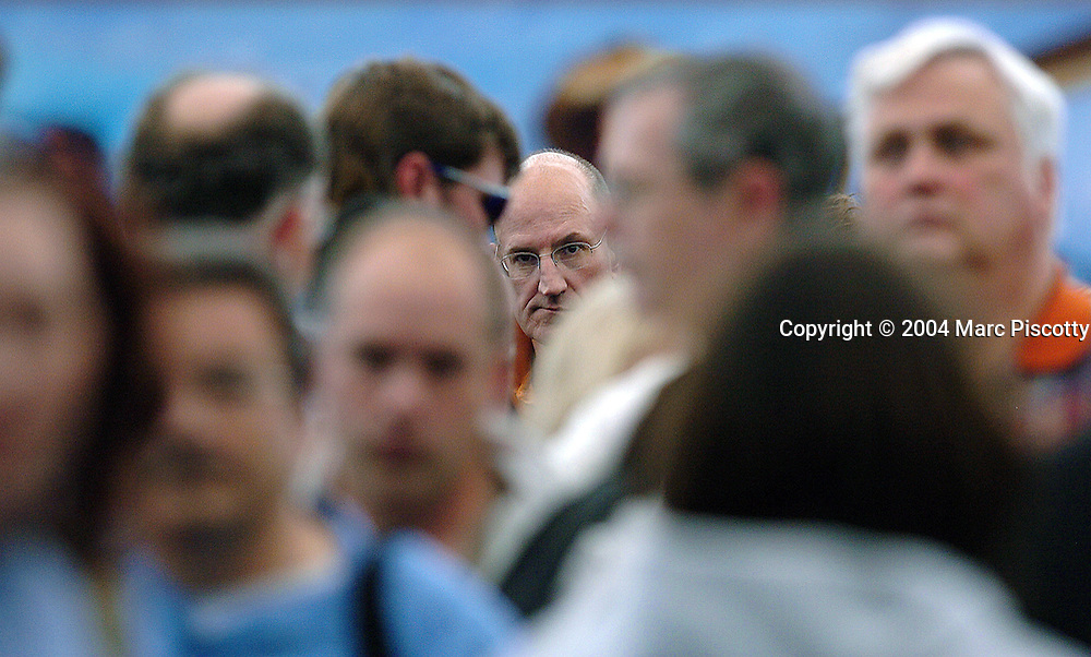 (DENVER, Co., SHOT 9/22/2004).Record numbers of travelers passed through Denver International Airport (DEN) in the month of July. Paul Peregrine of Denver, Co. waits in line for the TSA security checkpoint Wednesday while trying to fly out of Denver on his way to Cologne, Germany. Waits in the security line at DIA on Wednesday afternoon were averaging about 25 minutes..(Photo by MARC PISCOTTY / © 2004)