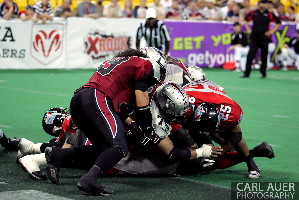 6-28-2007: Anchorage, AK - CenTex gets the ball across the line as Alaska tries to stop them with a pile as the CenTex Barracudas hand the Alaska Wild another loss 53-47 as the Barracudas make the trip up to Alaska.
