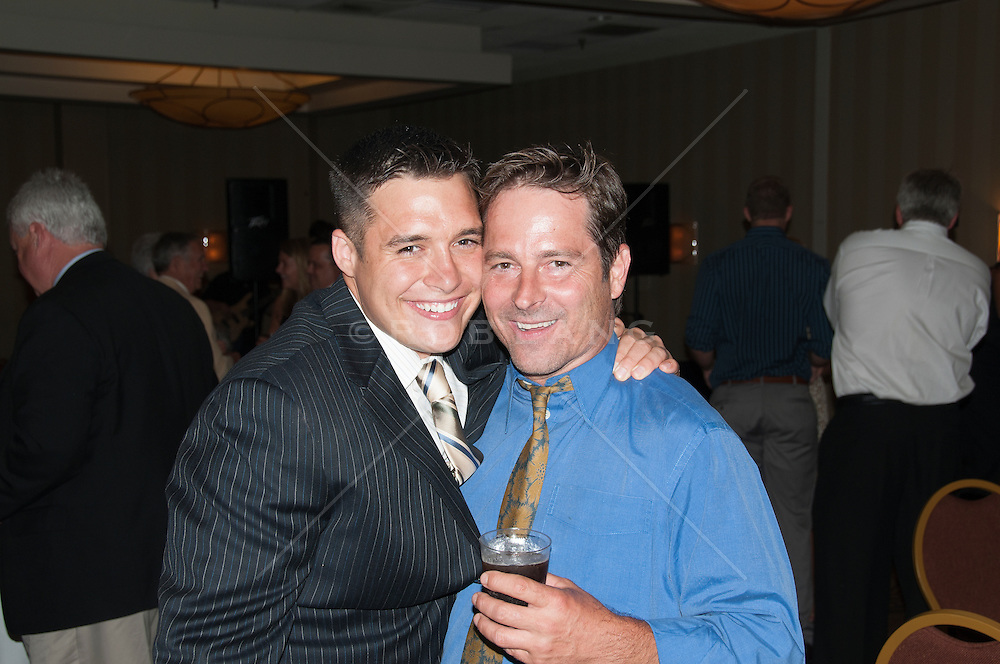father and son at party reception