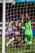Matilde Lundorf (Brighton) & Erin Cuthbert (Chelsea) with Megan Walsh (GK) (Brighton) saving the ball during the FA Women's Super League match between Brighton and Hove Albion Women and Chelsea at The People's Pension Stadium, Crawley, England on 15 September 2019.