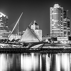 Picture of Milwaukee skyline at night in black and white. Picture includes the Milwaukee lakefront, Milwaukee Art Museum, University Club Tower, and Northwestern Mutual Tower. Photo is high resolution.