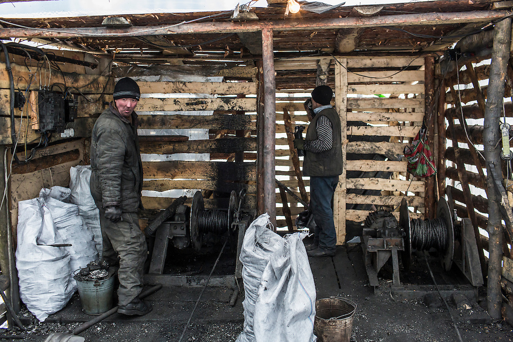 SNEZHNE, UKRAINE - JANUARY 25, 2015: Dmitry Kontratenko, left, and Sergei Danshin at the small private coal mine where they work in Snezhne, Ukraine. The mine produces approximately 15 tons of coal per day with a crew of four men. CREDIT: Brendan Hoffman for The New York Times