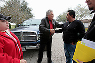 "Superintendent Ernest Singleton (center) greets parent Oscar Gonzalez, Jr., as Leticia M. Gonzalez (left) talks with Principal Enrique ""Rick"" Ruiz about their daughter's numerous absences Feb. 10, 2012 as district officials visit truant students' homes in Premont."