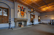 The King's Outer Hall, with the royal coat of arms above the fireplace, in Stirling Castle, with current buildings dating to 15th and 16th centuries, on Castle Hill, in Stirling, Scotland. This was a public function room and a waiting chamber for meetings with the king. The castle is listed as a scheduled ancient monument and is run by Historic Environment Scotland. Picture by Manuel Cohen