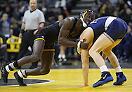 January 29, 2010: Iowa's Montell Marion battles Penn State's Adam Lynch for control in the 141-pound bout at Carver-Hawkeye Arena in Iowa City, Iowa on January 29, 2010. Lynch won the match 8-6 and Iowa defeated Penn State 29-6.