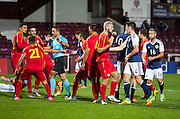 Refereee Sebastian Coltescu is surrounded by FYR Macedonia players after awarding a late penalty to Scotland Under-21s during Scotland Under-21 v FYR Macedonia,  UEFA Under 21 championship qualifier  at Tynecastle, Edinburgh. Photo: David Young<br /> <br />  - © David Young - www.davidyoungphoto.co.uk - email: davidyoungphoto@gmail.com