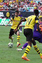 July 22, 2018 - Charlotte, NC, U.S. - CHARLOTTE, NC - JULY 22: Christian Pulisic (22) of Borussia Dortmund keeps his eye on the ball as he takes a shot to score a goal during the International Champions Cup soccer match between Liverpool FC and Borussia Dortmund in Charlotte, N.C. on July 22, 2018. (Photo by John Byrum/Icon Sportswire) (Credit Image: © John Byrum/Icon SMI via ZUMA Press)