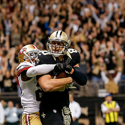 Nov 9, 2014; New Orleans, LA, USA; New Orleans Saints tight end Jimmy Graham (80) catches a touchdown in front of San Francisco 49ers cornerback Chris Culliver (29) during the third quarter of a game at Mercedes-Benz Superdome. Mandatory Credit: Derick E. Hingle-USA TODAY Sports