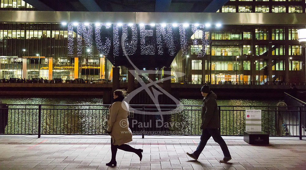 Canary Wharf, London, January 16 2018. Falling water creates words in 'Bit.Fall by Julius Popp of Germany at the Winter Lights festival at Canary Wharf in London which features over 30 spectacular light installations at interactive art. © Paul Davey
