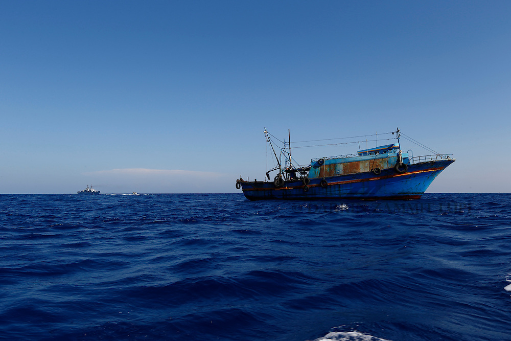A wooden boat from which migrants were rescued is seen at the end of the operation 10.5 miles (16 kilometres) off the coast of Libya August 6, 2015.  An estimated 600 migrants on the boat were rescued by the international non-governmental organisations Medecins san Frontiere (MSF) and the Migrant Offshore Aid Station (MOAS) without loss of life on Thursday afternoon, according to MSF and MOAS, a day after more than 200 migrants are feared to have drowned in the latest Mediterranean boat tragedy after rescuers saved over 370 people from a capsized boat thought to be carrying 600.<br /> REUTERS/Darrin Zammit Lupi <br /> MALTA OUT. NO COMMERCIAL OR EDITORIAL SALES IN MALTA