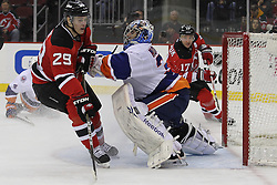 Apr 3; Newark, NJ, USA; New York Islanders goalie Al Montoya (35) hits New Jersey Devils defenseman Mark Fayne (29) during the second period at the Prudential Center.