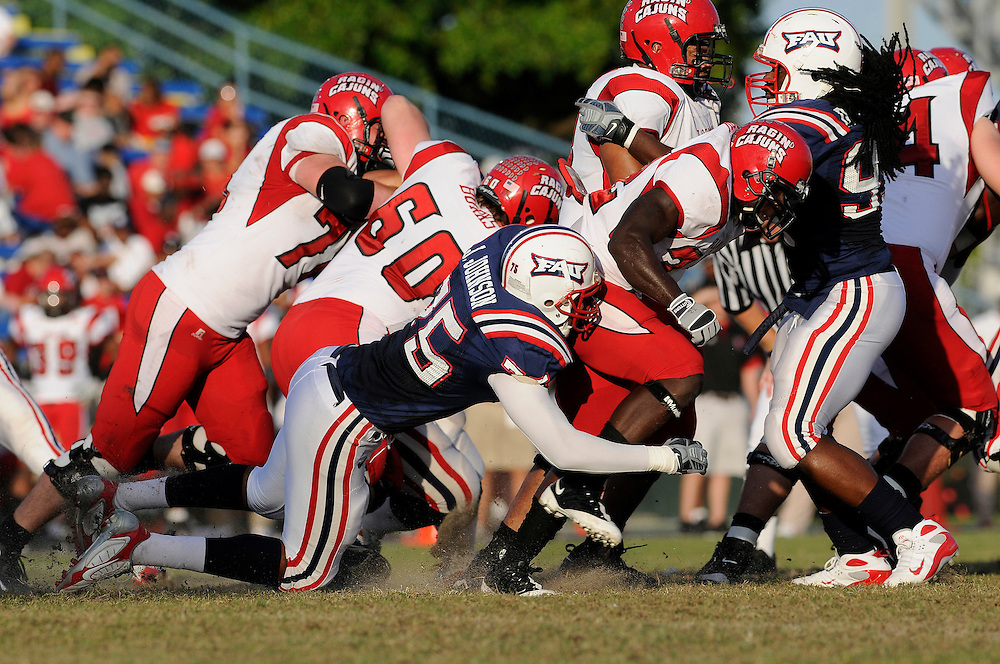 November 15, 2008: Jamere Johnson of Florida Atlantic tackles Tyrelle Fenroy of Louisiana-Lafayette during the NCAA football game between the Florida Atlantic Owls and the Louisiana-Lafayette Ragin' Cajuns. The Owls defeated the Ragin' Cajuns 40-29.