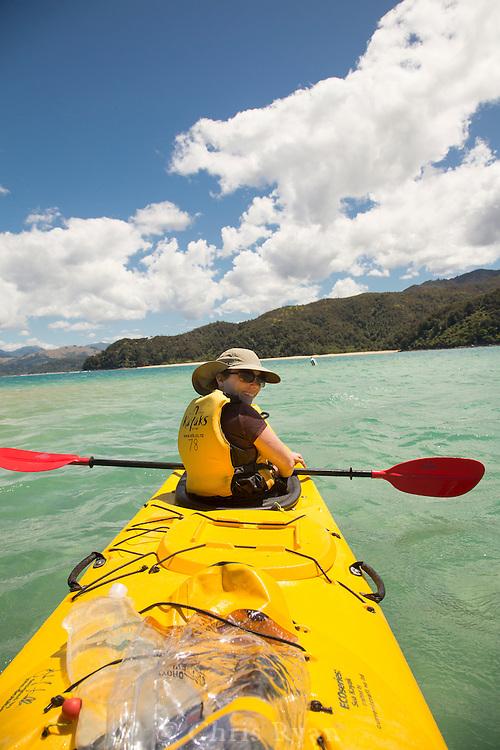 Kayaker in Tasman Bay, Abel Tasman National Park, South Island, New Zealand