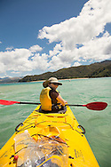 Kayaker in Tasman Bay, Abel Tasman National Park, South Island, New Zealand