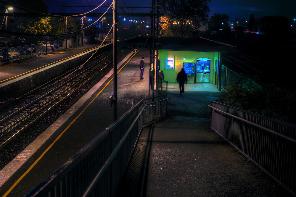 Railway Stations at night. About 6:40pm West Footscray station, a man stands on the outbound platform as a shadowy figure approaches. Pic By Craig Sillitoe CSZ/The Sunday Age/The Age iPad App.15/6/2011 melbourne photographers, commercial photographers, industrial photographers, corporate photographer, architectural photographers, This photograph can be used for non commercial uses with attribution. Credit: Craig Sillitoe Photography / http://www.csillitoe.com<br />
