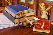 Bible, hymn books and notepad await the afternoon liturgy at Duzi Serbian Orthodox monastery near Trebinje, Republika Srpska, Bosnia and Herzegovina.