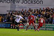 Stephen Davies gets a shot off during the Capital One Cup match between York City and Bradford City at Bootham Crescent, York, England on 11 August 2015. Photo by Simon Davies.