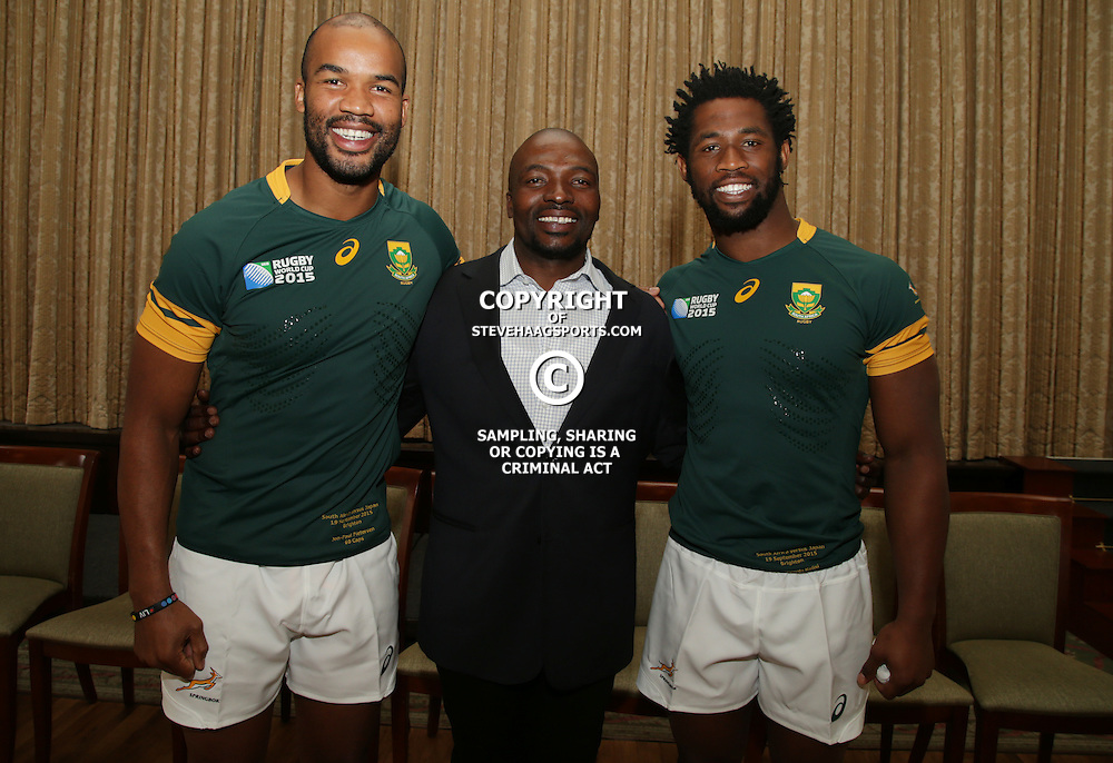 EASTBOURNE, ENGLAND - SEPTEMBER 18: JP Pietersen with Owen Nkumane Supersport rugby commentator and Siya Kolisi  during the South African Springboks Official team photograph at Grand Eastbourne Hotel on September 18, 2015 in Eastbourne, England. (Photo by Steve Haag)