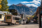 """Galloping Goose transit bus in Telluride, Colorado, San Juan Mountains, USA. The name Galloping Goose is used with the permission of the Galloping Goose Historical Society of Dolores, Inc. The original seven Galloping """"Geese"""" railcars were built in the 1930s (then named RGS """"Motors"""") to cart U.S. Mail, passengers and freight along the Rio Grande Southern (RGS) Railroad throughout southwestern Colorado, from Ridgway to Telluride, Rico, Dolores and Durango. All seven gasoline-engine railbuses have been restored to their former glory."""