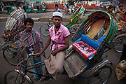 A rickshaw driver waits for customers at the Central Train Station in Dhaka, Bangladesh.