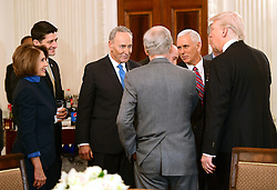 United States President Donald Trump, right, hosts a reception for US House and US Senate Republican and Democratic leaders in the State Dining Room of the White House in Washington, DC, USA, on Monday, January 23, 2017. Photo by Ron Sachs/CNP/ABACAPRESS.COM