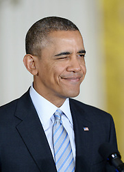 61056583<br /> U.S. President Barack Obama blinks during signing an executive order to raise the minimum wage for federal contract workers in the East Room of the White House in Washington D.C., the United States, Feb. 12, 2014.The move, first announced during the State of the Union address, will raise the minimum wage for federal contractors to 10.10 dollars per hour from the current rate of 7.25 dollars, Washington D.C., the United States, Wednesday, 12th February 2014. Picture by  imago / i-Images<br /> <br /> UK ONLY