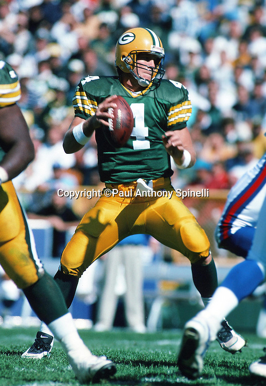 Green Bay Packers quarterback Brett Favre (4) drops back to pass during the NFL football game against the New York Giants on Sept. 17, 1995 in Green Bay, Wis. The Packers won the game 14-6. (©Paul Anthony Spinelli)