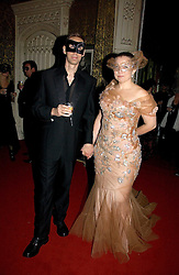 Photographer NICK KNIGHT and his wife CHARLOTTE at the 2006 Moet & Chandon Fashion Tribute in honour of photographer Nick Knight, held at Strawberry Hill House, Twickenham, Middlesex on 24th October 2006.<br />