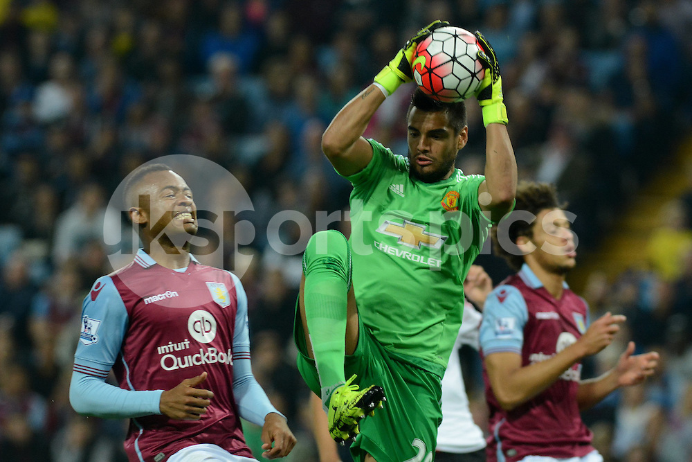 Manchester United's goalkeeper Sergio Romero collects a cross during the Barclays Premier League match between Aston Villa and Manchester United at Villa Park, Birmingham, England on 14 August 2015. Photo by Garry Griffiths.